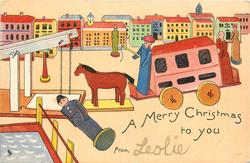 A MERRY CHRISTMAS TO YOU  prostrate wooden figure front left, wooden horse & van moves left, houses behind