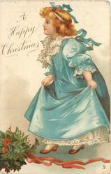A HAPPY CHRISTMAS  golden haired girl in blue outfit steps left, holly bunch below