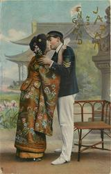 sailor in uniform (3 stripes) kisses geisha, his left arm on her right shoulder, her hands around his neck