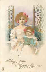 WISHING YOU A HAPPY CHRISTMAS  mother & child face front with book before window & seascape