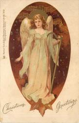 CHRISTMAS GREETINGS  angel holds harp, facing left/front, starry background
