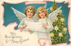 WITH BEST WISHES FOR A HAPPY CHRISTMAS two angels hold a sheet of music in front of lit christmas tree