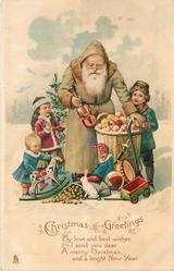 CHRISTMAS GREETINGS.   olive coated Santa holding small violin, with many toys & three children