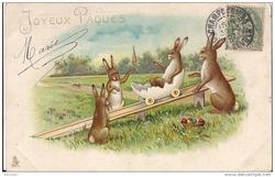 JOYEUX PAQUES three rabbits watch another ride in an egg boat down a slide