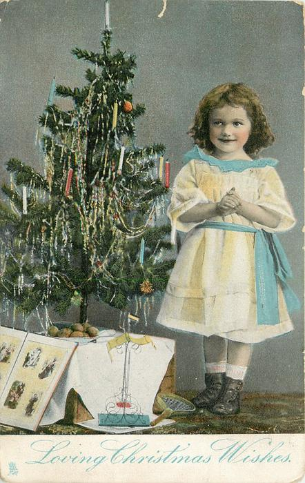 LOVING CHRISTMAS WISHES  girl standing next to Xmas tree