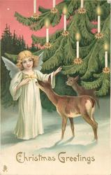 CHRISTMAS GREETINGS angel with two deer beside Christmas tree with candles