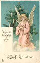 A JOYFUL CHRISTMAS  angel in front of Xmas praying