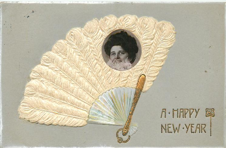A HAPPY NEW YEAR  photo insert, she looks up & front, white fan, pale purple background