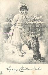 LOVING CHRISTMAS WISHES  girl stand in snow looking down at dog sitting up holding basket of flowers in mouth
