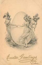 three young woman around large EASTER egg
