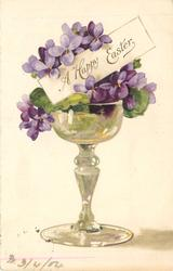 A HAPPY EASTER violets in wine glass-like vase