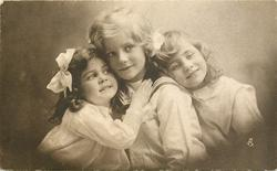 boy in sailor suit between two girls, left girl has hands high on boys chest on his collar, right girl rests head on his shoulder, anchor shows on boys shirt, all three look forward and right