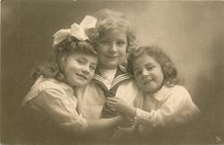 boy in sailor suit between two girls, left girl has hands boys chest, right girl has hands on his tie, both girls rests head on his shoulders, anchor shows on boys shirt, all three look forward