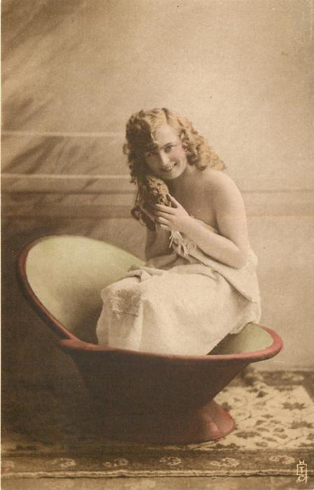 girl sitting holding sponge with both hands