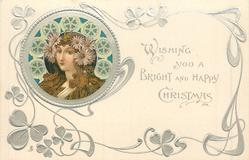 ***WISHING YOU BRIGHT AND HAPPY CHRISTMAS  head upper left, silver wheels around head, large flowers over each ear, she faces front/left