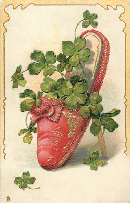 red slipper with pattern on left, containing  4 leaf clovers