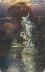 statue in pond of three figures intertwined