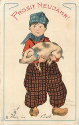 Dutch boy holds pig in his arms