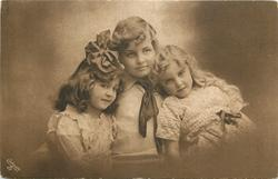 two girls on the end of the arms of a boy in the middle
