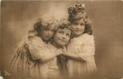two girls around boy in the middle, girls are holding hands with each other