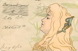 nouveau woman with gilt hair looks to the left, facing sideways