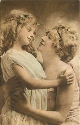 mother holds child in arms, mother to right, girls hands both on mother's left shoulder, mother's arms around girl, her right thumb not visable