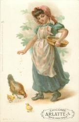 girl in green dress and white flowery apron feeding hen and two chicks