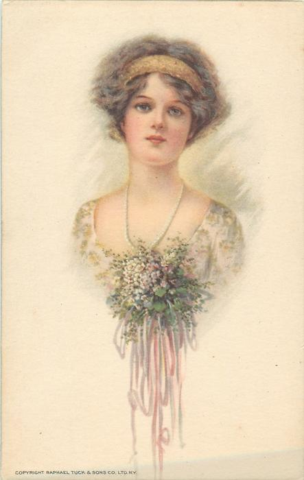 head & shoulders of pretty girl wearing pearl necklace & large flower corsage