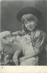 child facing left, head tilted slightly left, looking up right, left hand and right arm visible, toy lamb left