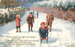 A MERRY CHRISTMAS (gilt or red ) children on snowy path, one rides sled