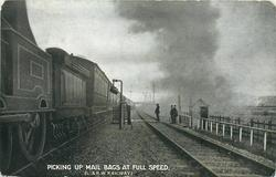PICKING UP MAIL BAGS AT FULL SPEED (L. & N. W. RAILWAY)