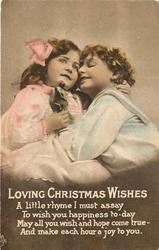 LOVING CHRISTMAS WISHES  boy and girl embrace, girl holds tulips