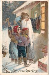CHRISTMAS GREETINGS  blue robed Santa with boy & girl stand looking into lighted window