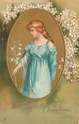 WISHING YOU A HAPPY CHRISTMAS oval inset pretty girl with golden hair in blue gown with sparse flowers behind, faces left