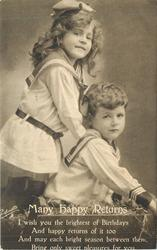 MANY HAPPY RETURNS girl stands left with hands on shoulders of kneeling boy right, both look front