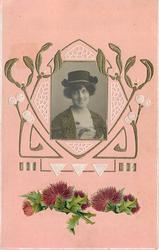 art deco design with photographic insert of woman, flowers below