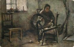 granny sits at spinning wheel