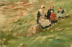 mother and three children on grassy hillside