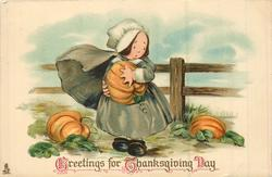 GREETINGS FOR THANKSGIVING DAY  woman picking pumpkins