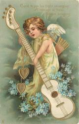 CUPID TO YOU HIS FLIGHT IS WINNING A MESSAGE IN THESE FLOWERS BRINGING  cupid supports large guitar, blue forget-me-nots