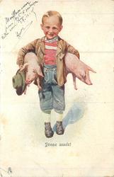 boy holds pig under each arm