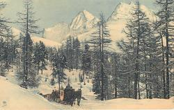 snow scene, horse-drawn sledges come front up hill, mountains behind