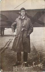 pilot W. AMSTRONG stands in front of  airplane wing