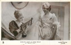 "EVELYN LAYE AND GINA MALO IN ""WALTZ TIME""  woman left looking in mirror, other right in maid uniform"