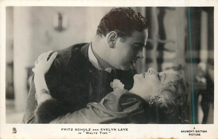 "FRITZ SCHULZ AND EVELYN LAYE IN ""WALTZ TIME""  she is in his arms"