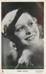 PAMELA OSTRER faces left, looks right & up, wears hat & very light veil, fur colllar