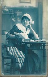 girl in Dutch costume, seated at writing table facing right looking down at letter held in her right hand, her left hand at neck