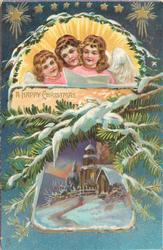 A HAPPY CHRISTMAS 3 angels sing above snowy evergreens & vignette of church