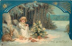 CHRISTMAS GREETINGS angel sits by fire between deer & Christmas tree, ornate blue border above