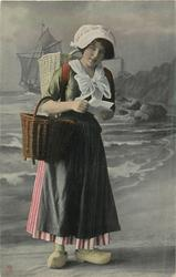 Dutch girl looks front, letter held with both hands, basket hangs from her right hand, red overskirt, with green stripes behind, bl/w  background of coast & sailing ship